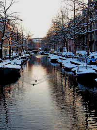 Snow white boats in the Lijnbaansgracht canal in the Jordaan in amsterdam