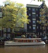 Prinsengracht concert on boats at Prinsengracht canal in front of Hotel Pulitzer in Amsterdam, The Netherlands